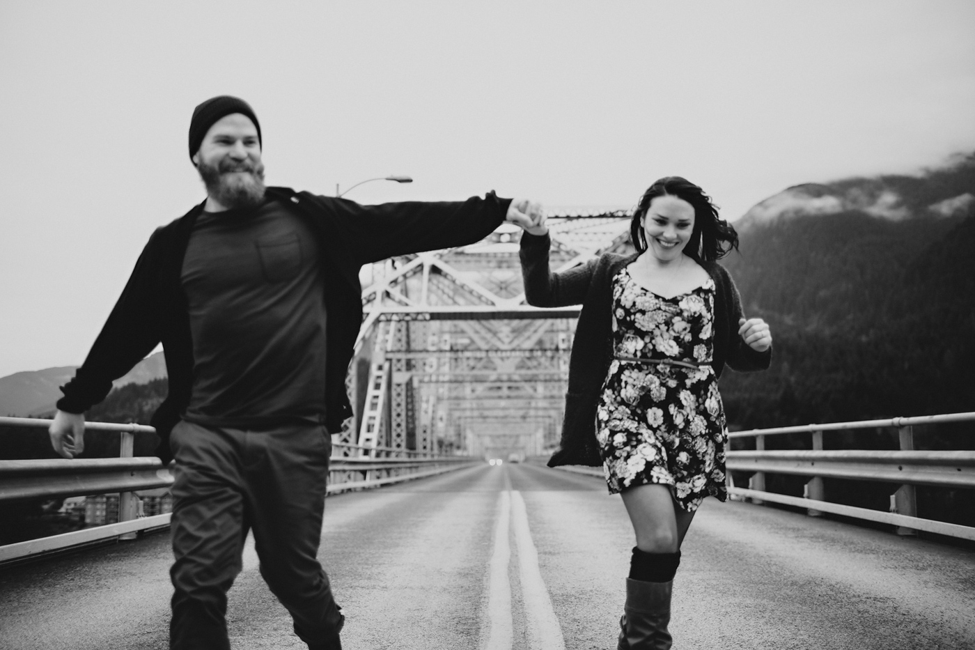 Portland couple running on steel bridge
