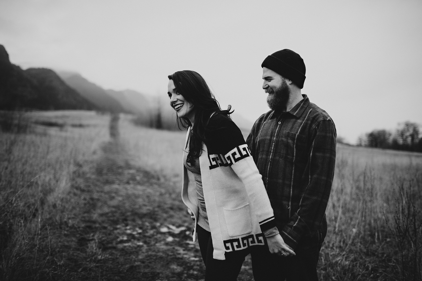 Loving couple playing in foggy field