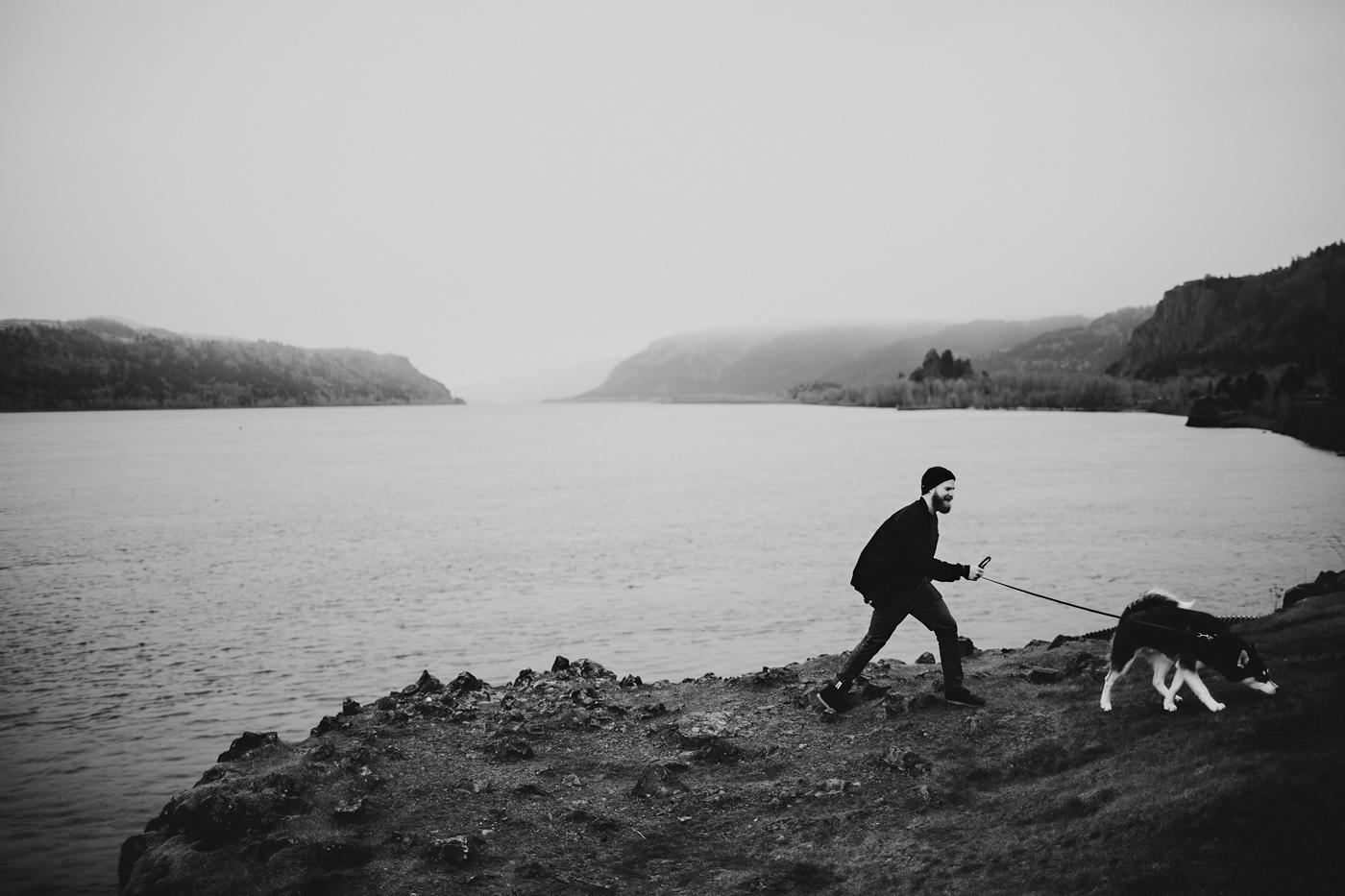 Man walks dog in foggy portland