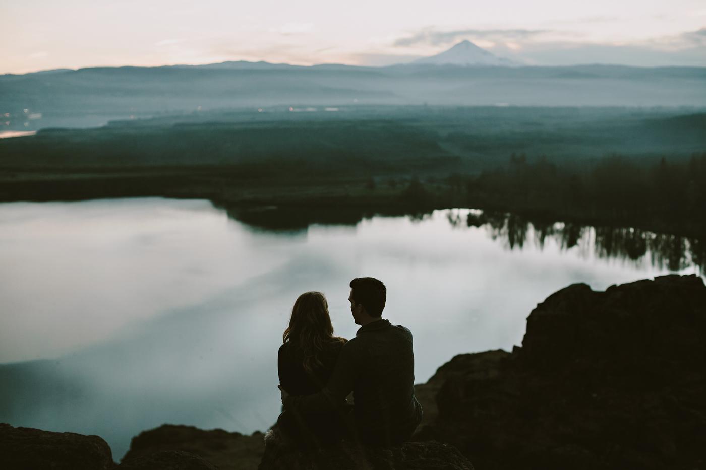 Couple overlooks mt hood from the desert at sunset