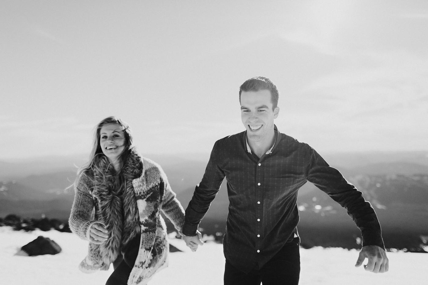 Couple running up mountain