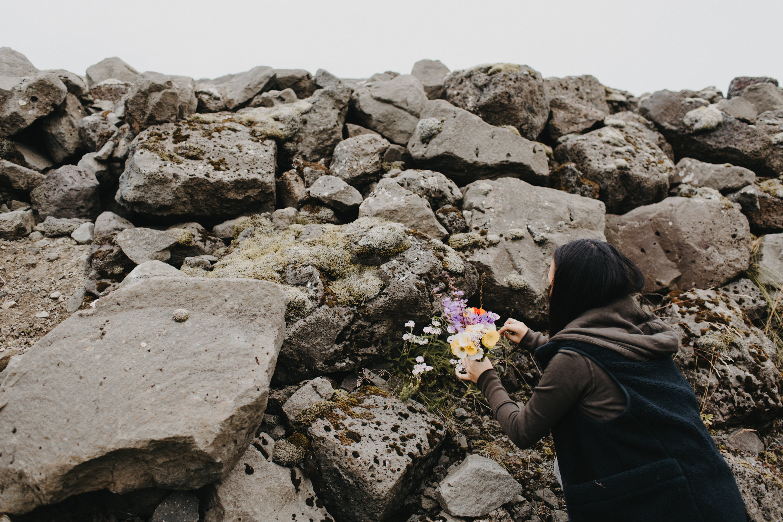 Iceland Elopement bride picking flowers for her crown