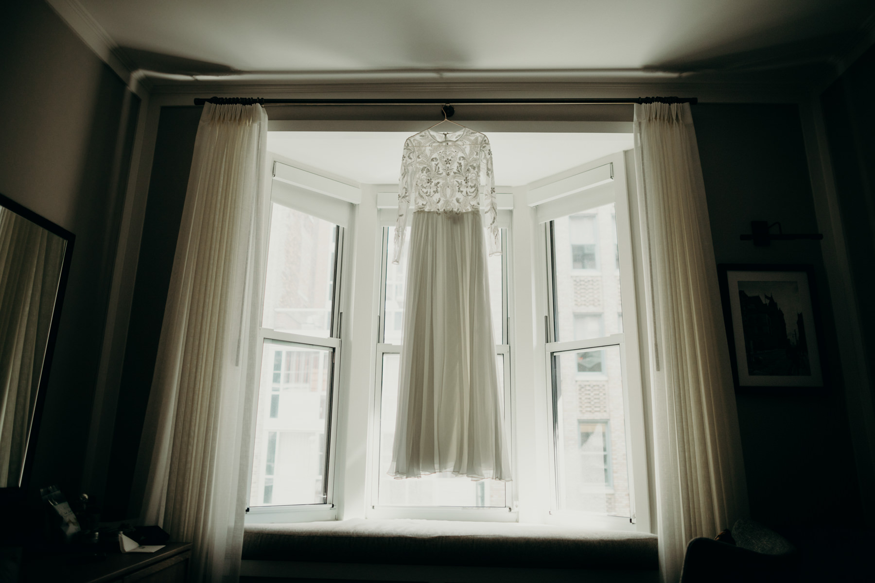 New York City Elopement Dress Hanging in Window