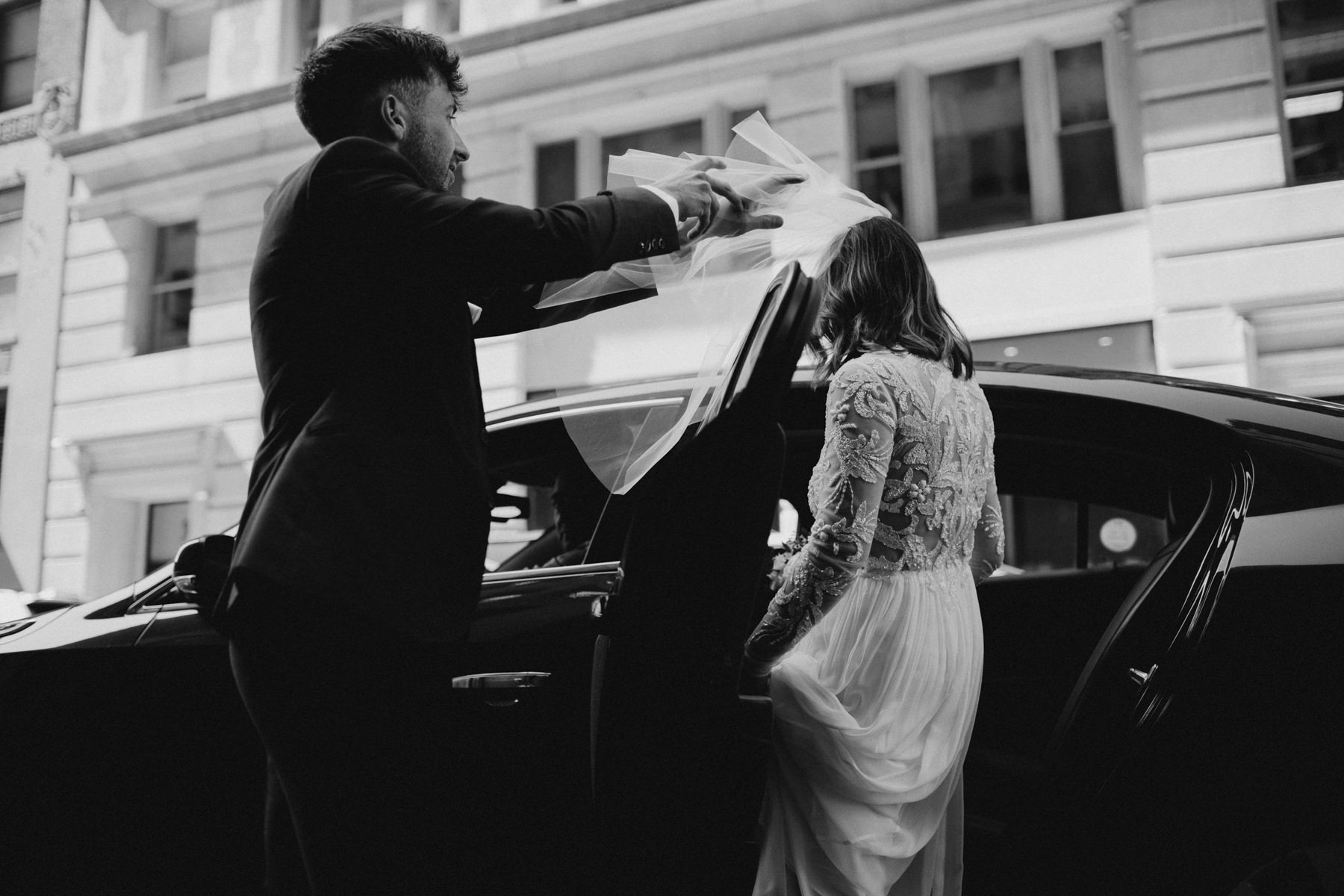 Bride getting into cab