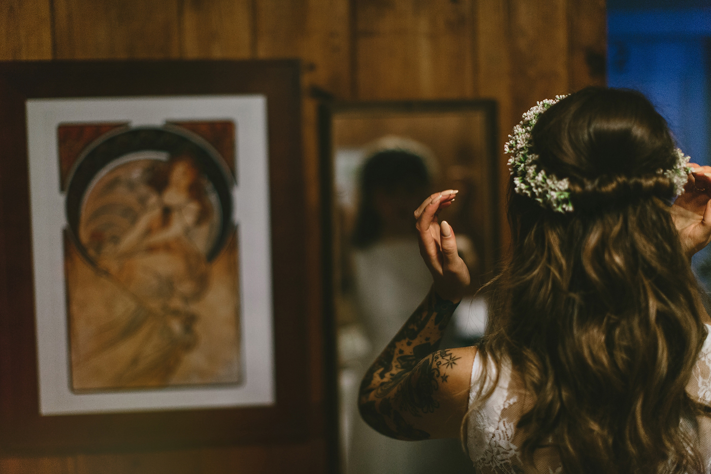 Bride putting on floral crown