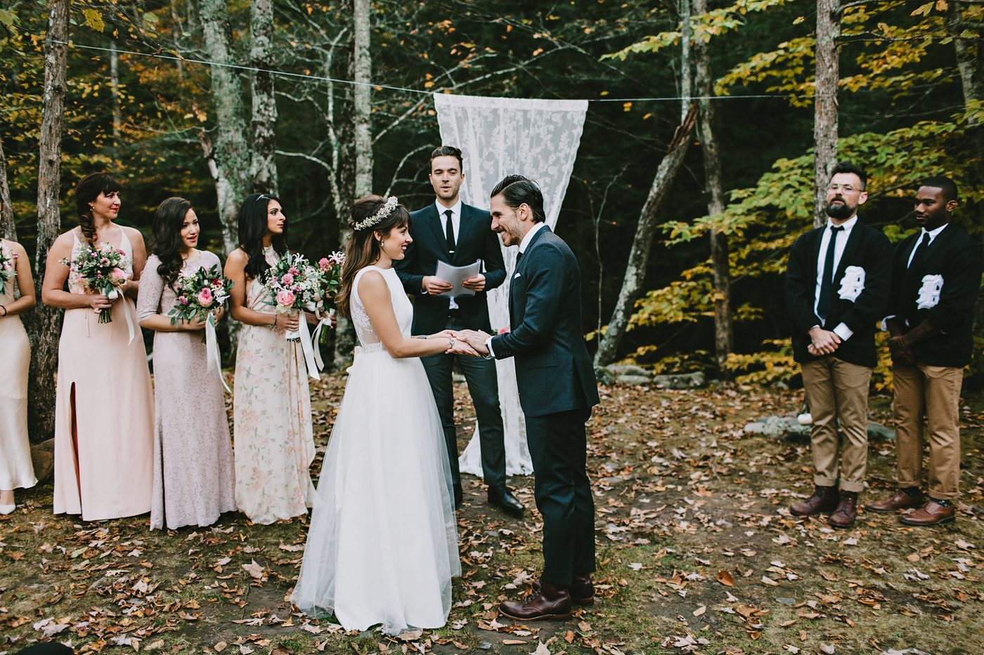 Cute couple exchanges vows at an autumn wedding