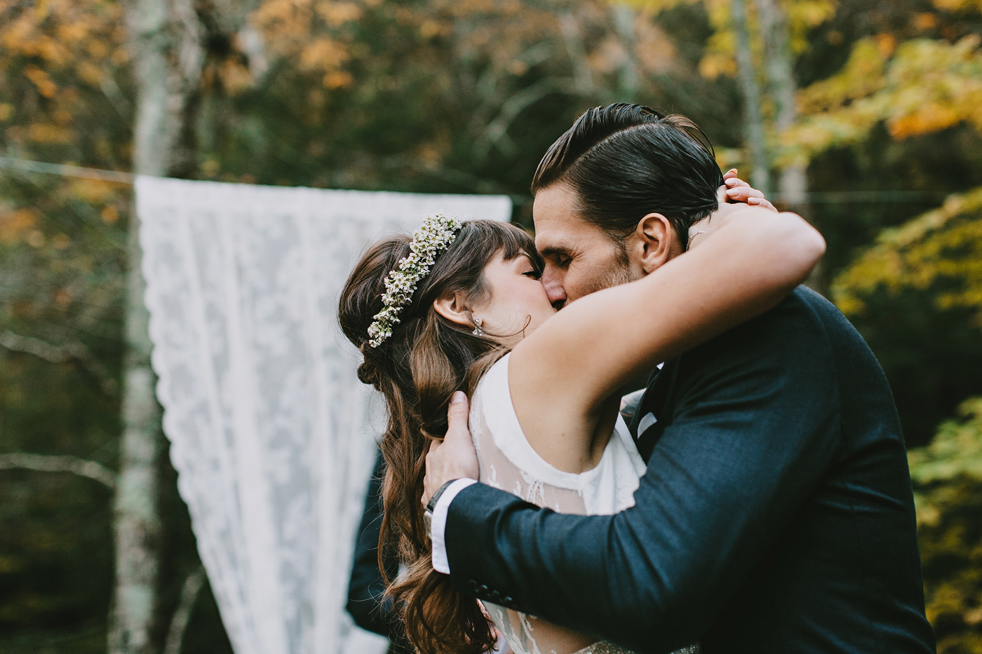 couple kisses during their autumn new york wedding