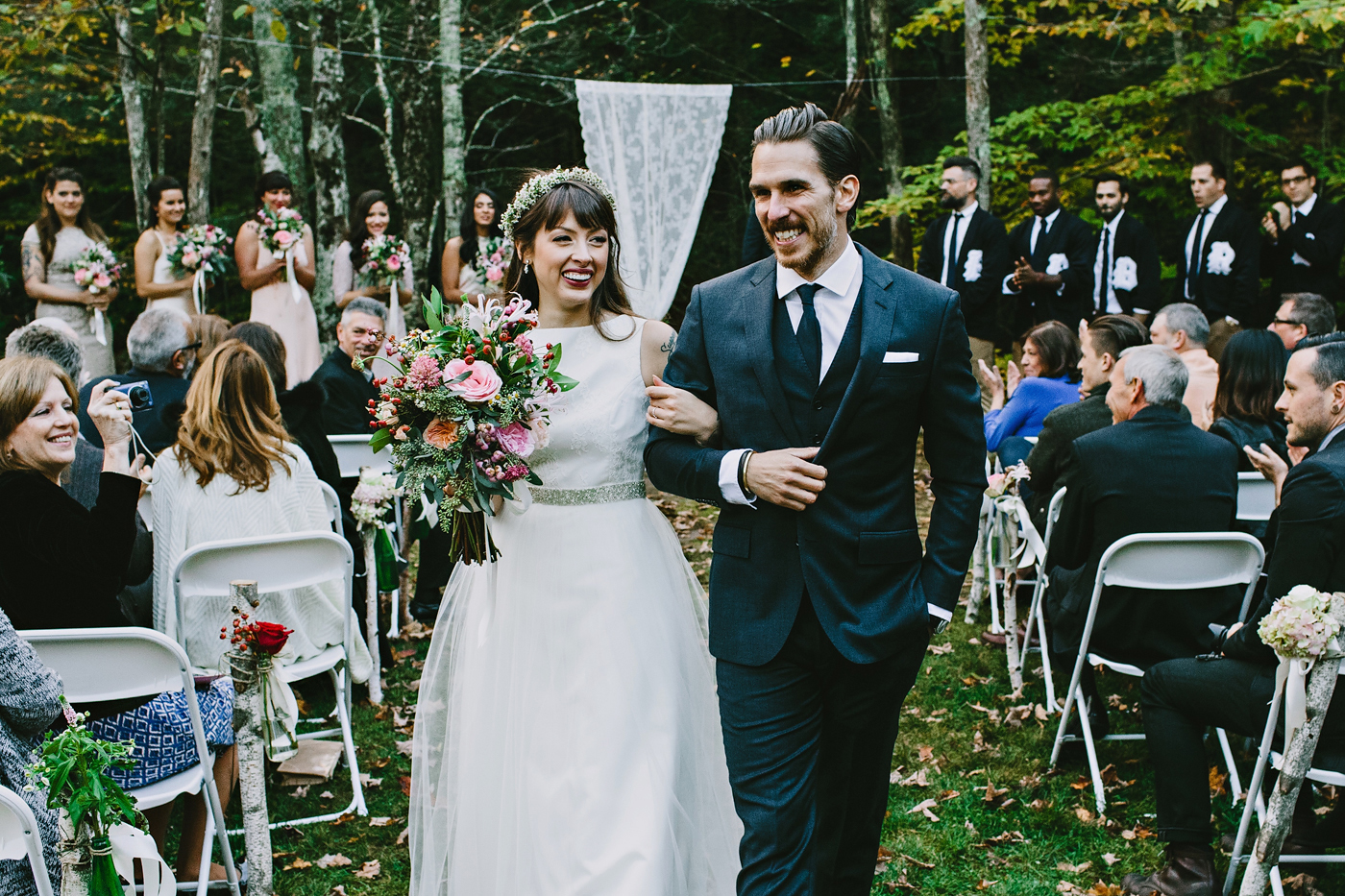 couple walks down isle after their beautiful fall ceremony