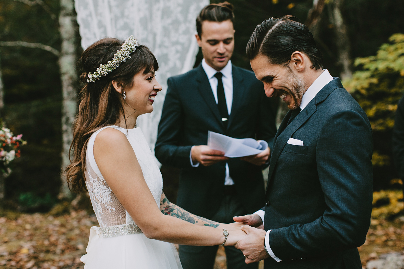 couple laughing while they exchange vows during their ceremony