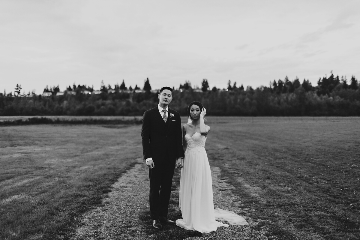 portrait of awesome couple at their seattle farm wedding