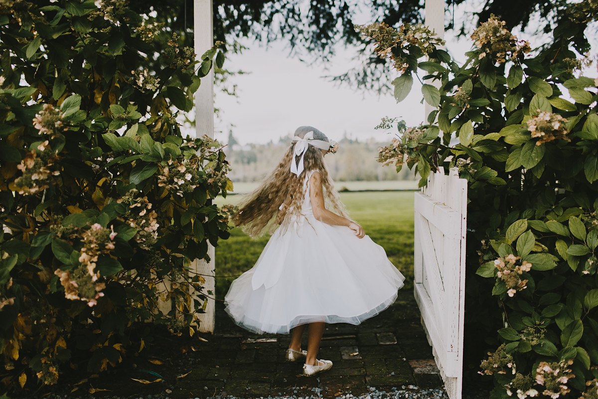 Flower girl twirling in dress