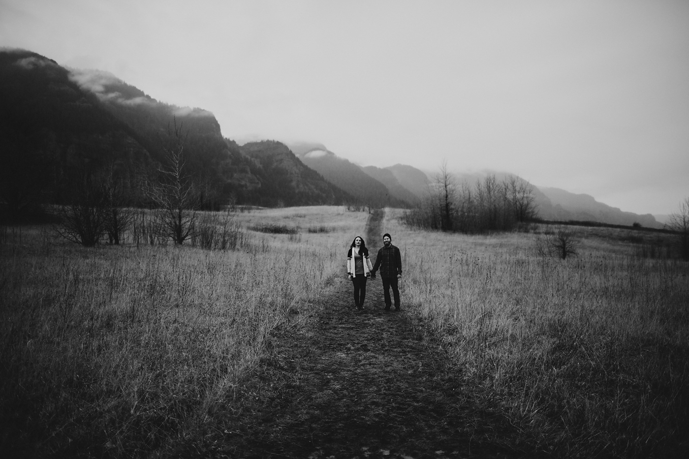 Couples stands in foggy field