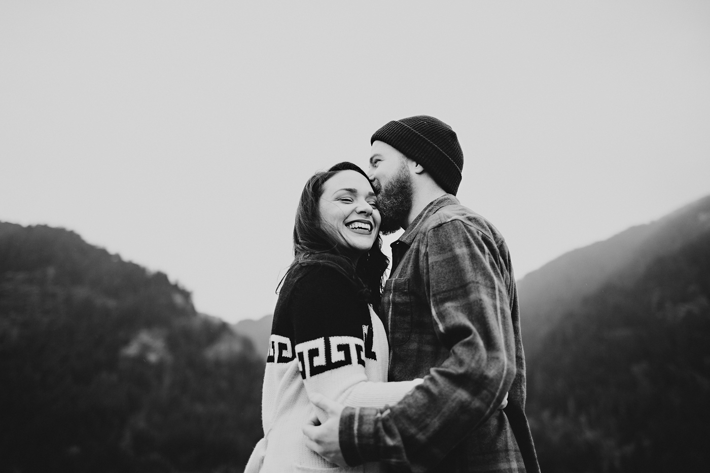 Hipster couple laughing together in Oregon mountains