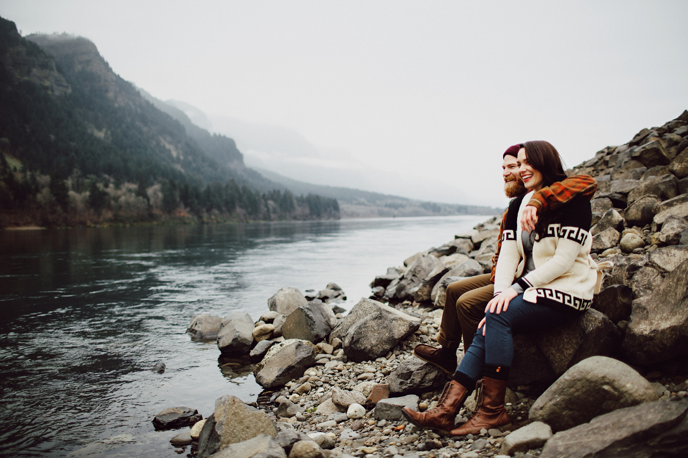 Cute couple sits near columbia river