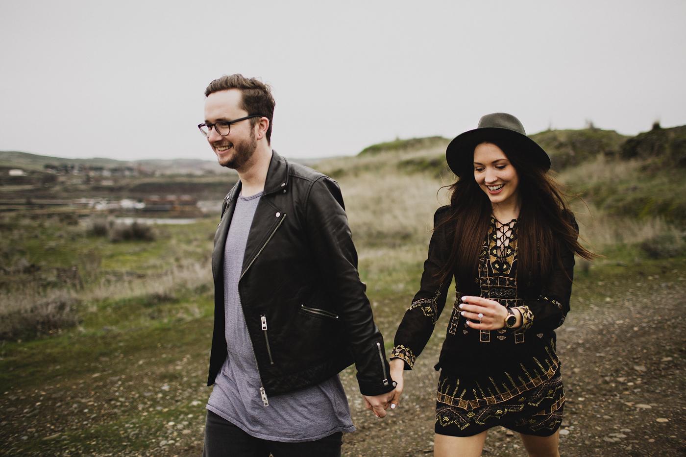cute couple walks through field