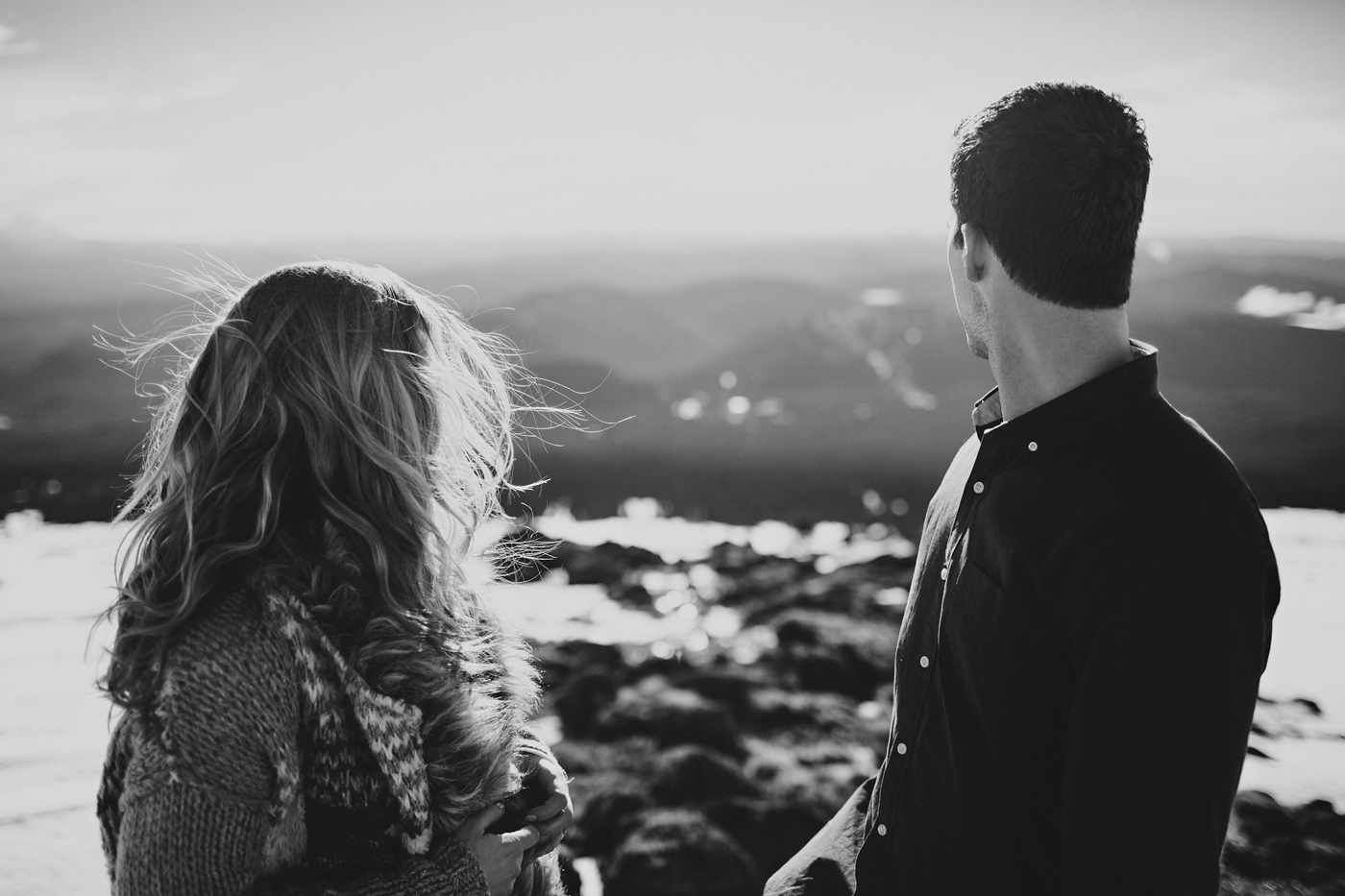 Couple looking down engagement photos