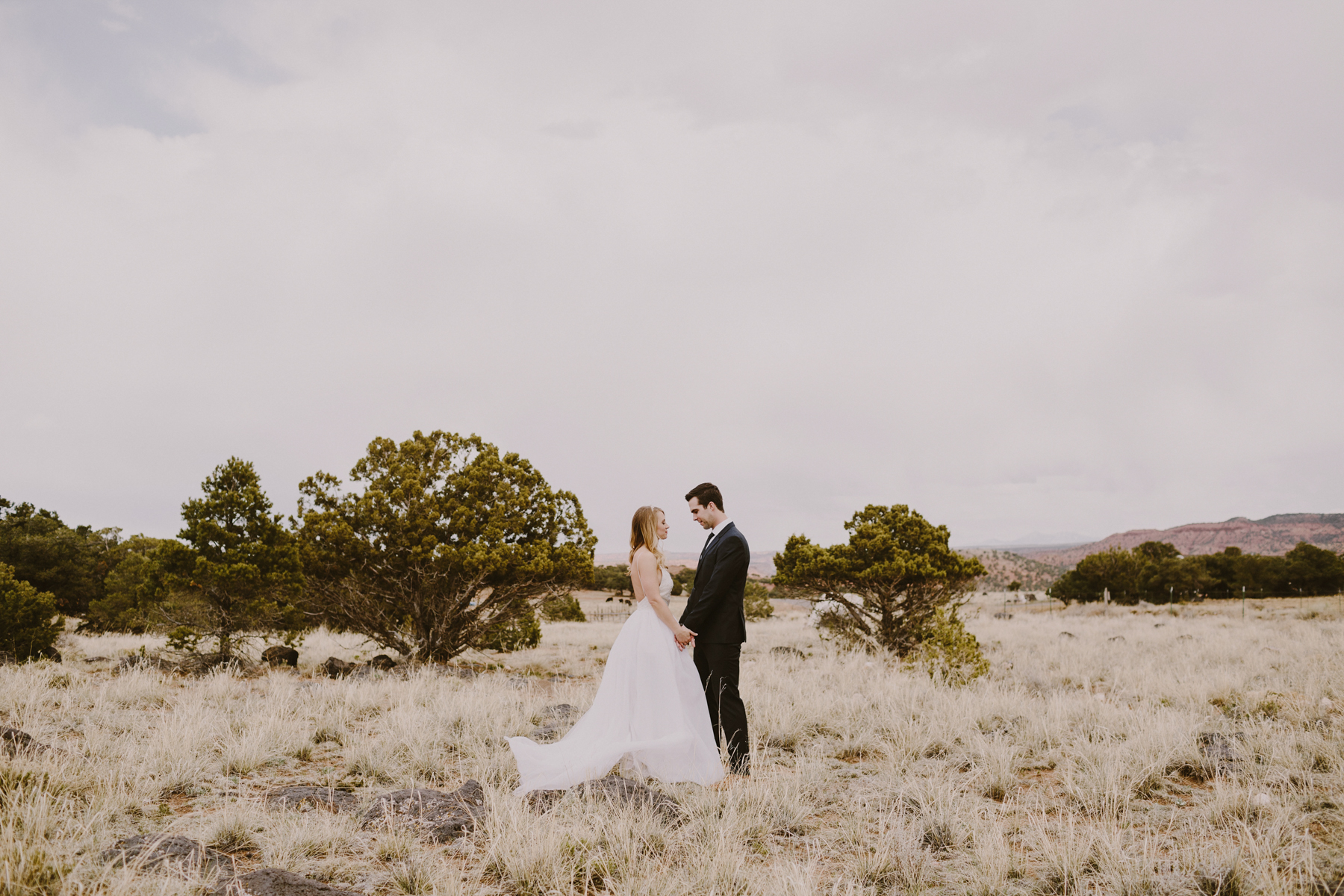 Couple holding hands on their wedding day in southern utah