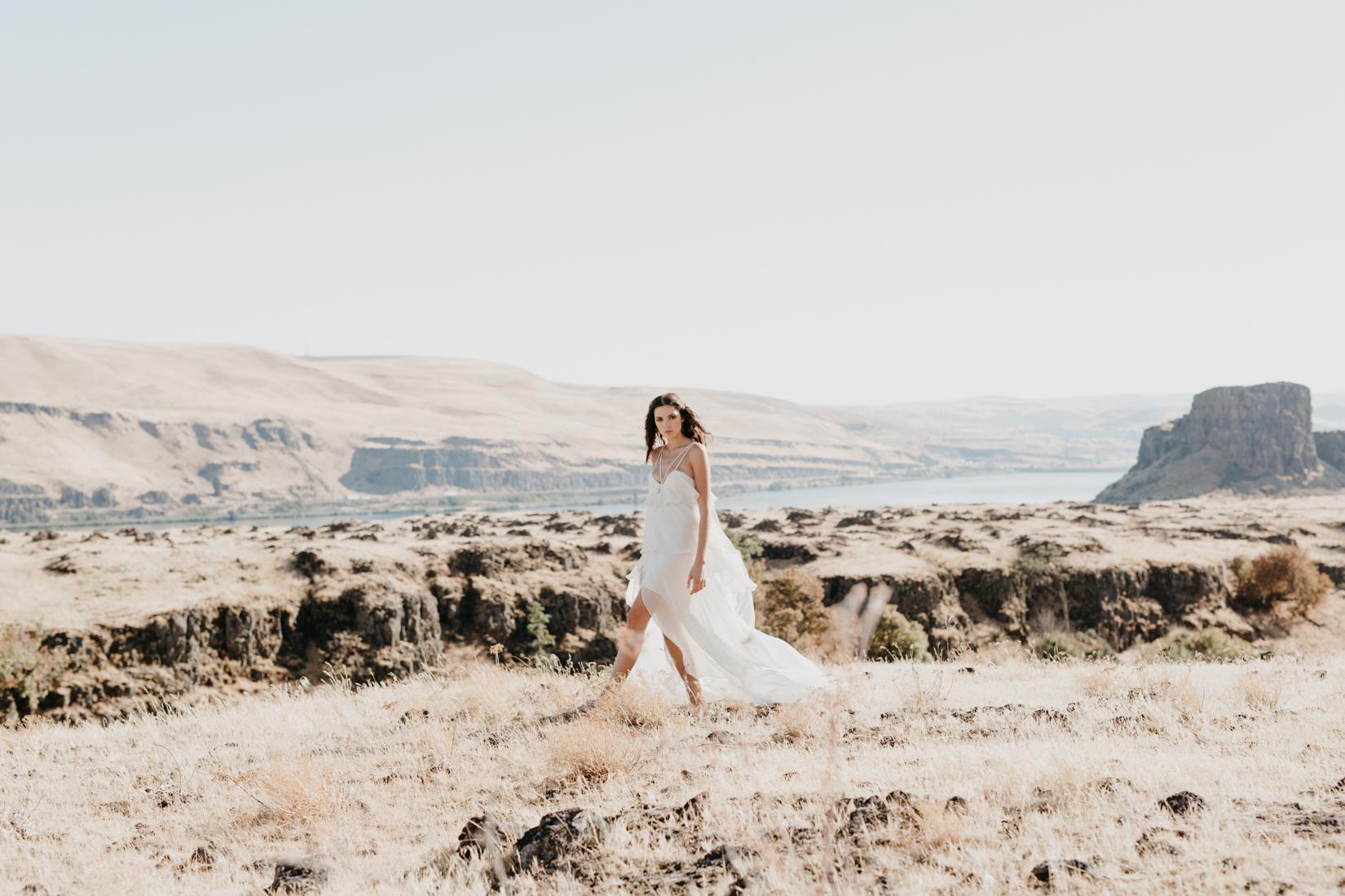 bride walks along dry brush in hood river oregon