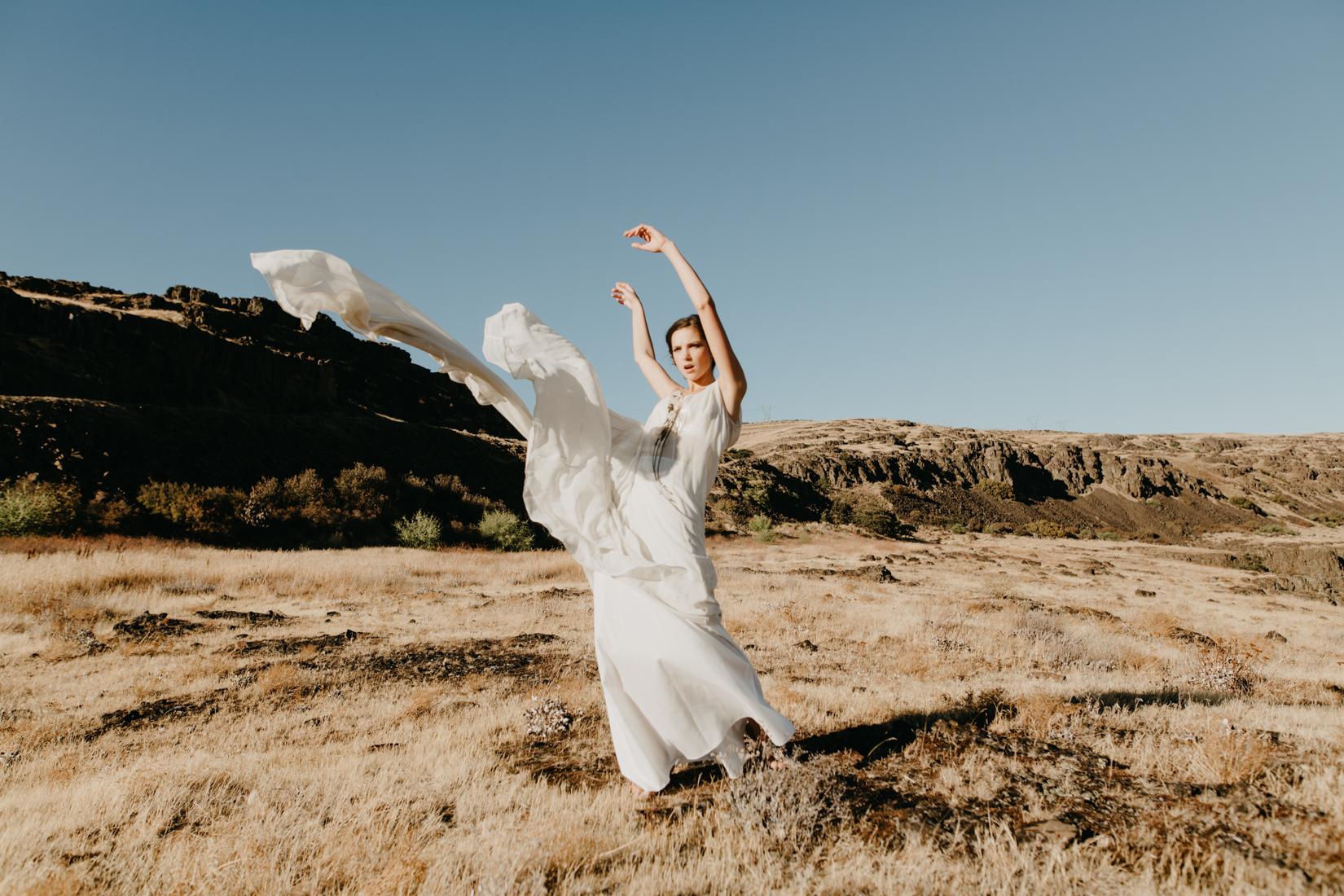 White wedding dress flying in the desert wind