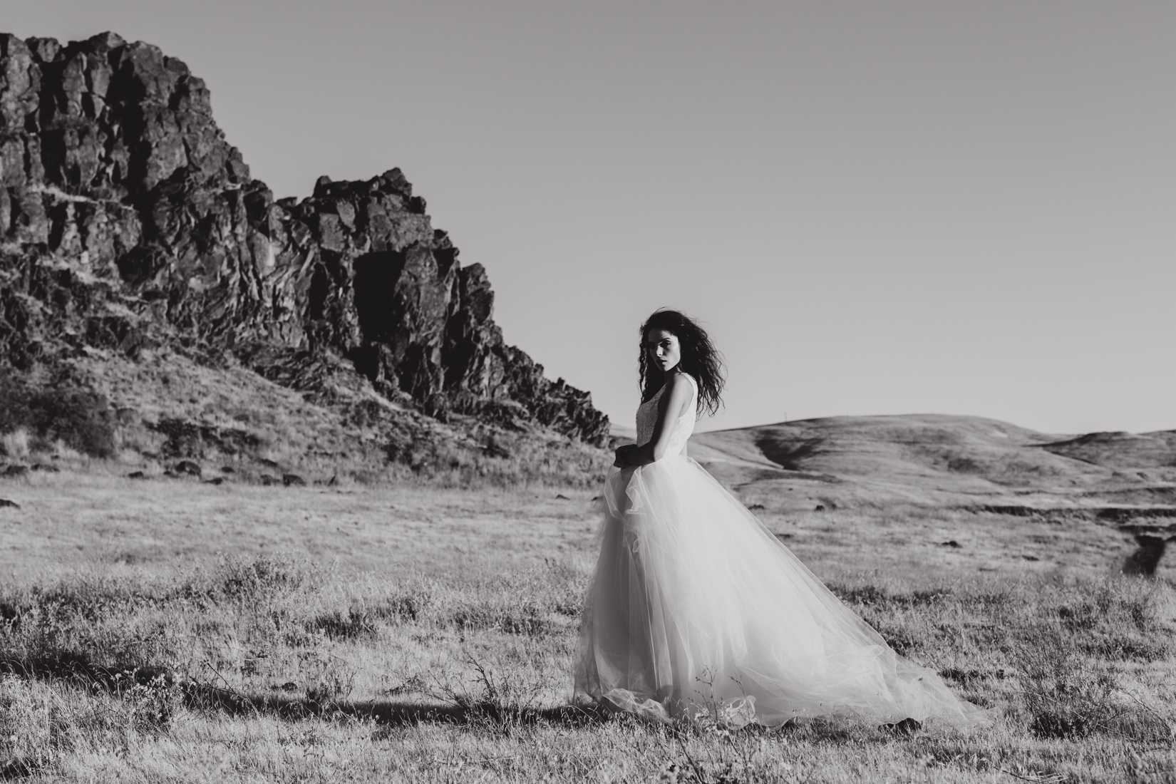 Black and white photo of bride in white wedding dress