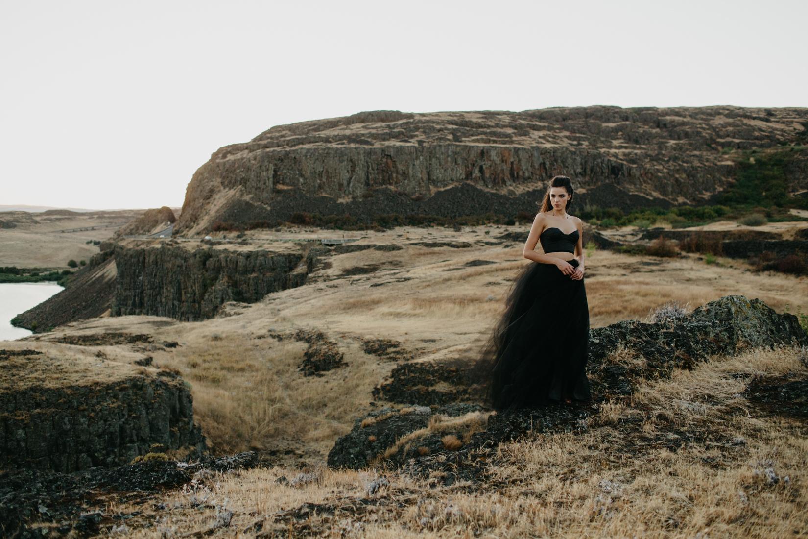 Bride wearing sexy black wedding dress in the Oregon desert