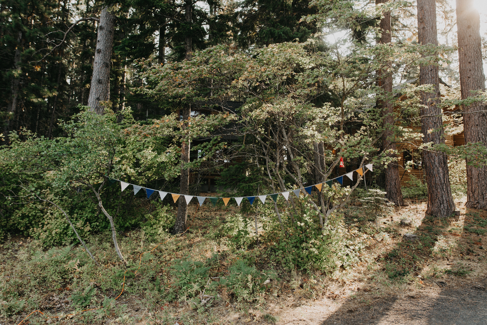 Vintage Wedding Flags at campground wedding in sisters oregon