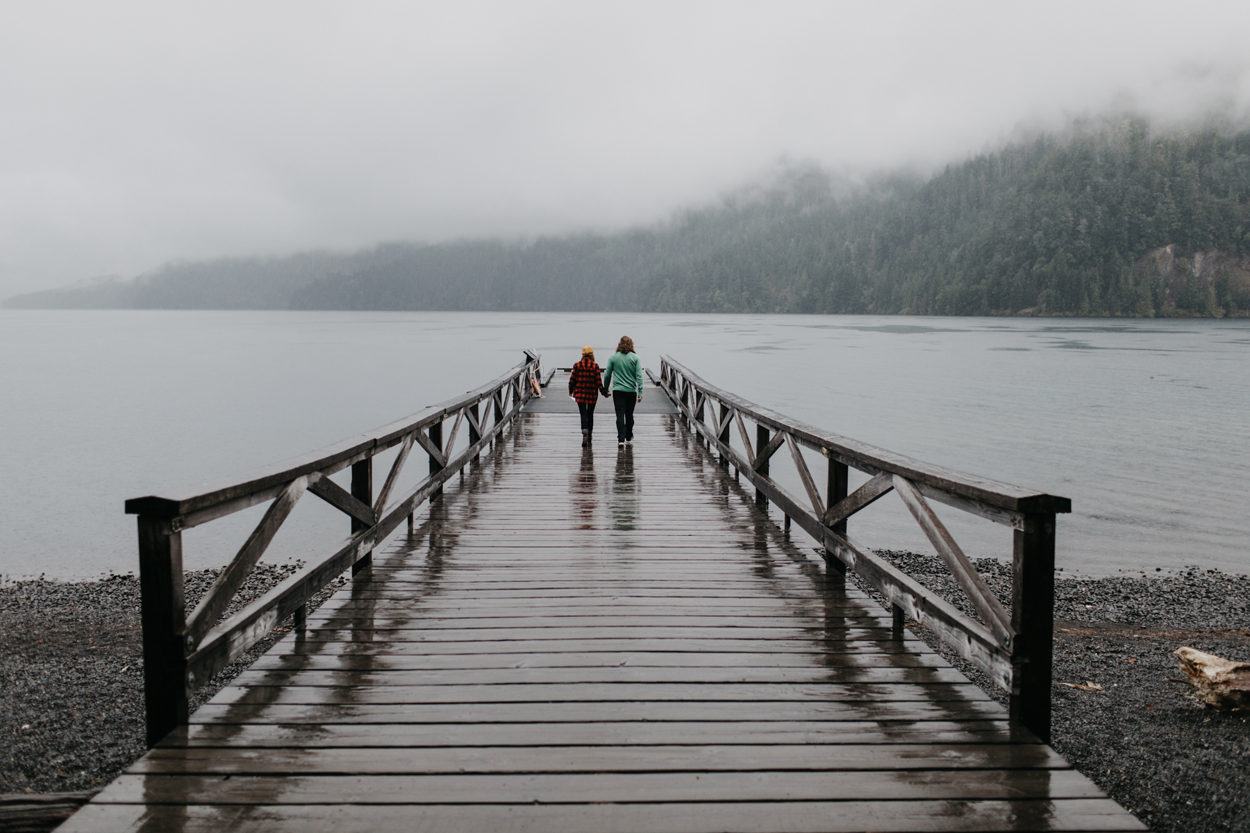 Couple walks out on dock together to read vows